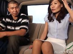 Japanese milf is enjoying some games in the car
