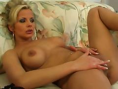MILF Adrianna Russo rubs her shaved pussy on a sofa