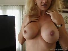 Blonde MILF Shows Her Huge Boobs While She Gobbles A Hard Cock