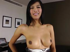 Busty Asian shemale jerks off her big cock and dildos herself