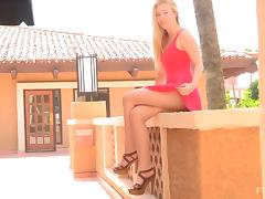 Blonde teen masturbates with a squash outdoors