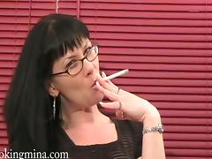 Gorgeous Cougar Playing With Her Massive Natural Tits While Smoking