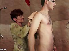 Short-haired brunette mom blows and gets fucked from behind
