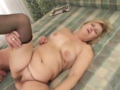 Hardcore sex vid with mature blond Evelin getting her meaty vag banged