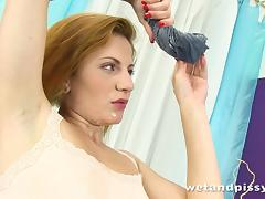 Ritta Red fucks her bumhole with a dildo in piss fetish clip