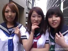 Three Japanese skanks play with a guy's prick in reality clip