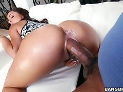 A Latina girl gags on a big black cock then gets fucked hard