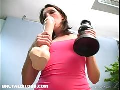 Dazzling solo model brunette with small tits feasting her shaved pussy using huge toy