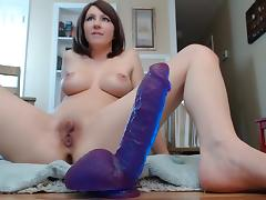 Gal with big bust plays with sex toy