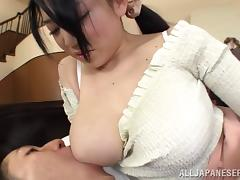 Dainty Asian doll stimulated as her big tits gets sucked as she gives a sensual handjob