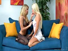 Captivating blonde lesbian with long hair enjoying her pussy being licked on sofa