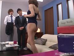 In the office this Japanese girl fucks one guy while sucking another