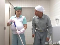 Mature Asian lets a guy play with her enormous boobs in a WC