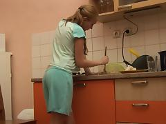Petite Jessica Neight plays with her shaved pussy in the kitchen