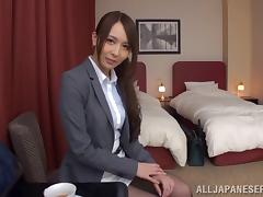 Naughty Japanese cowgirl with long hair masturbating passionately on her bed
