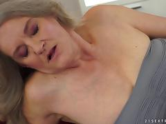 A lesbian granny seduces a younger chick for some pussy licking fun